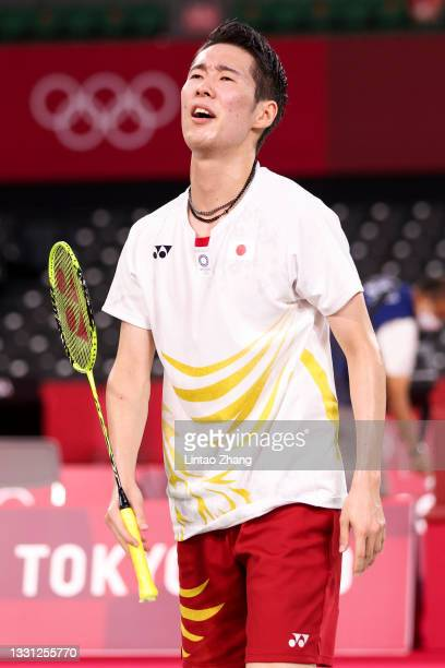 Kanta Tsuneyama of Team Japan reacts as he competes against Anthony Sinisuka Ginting of Team Indonesia during a Men's Singles Round of 16 match on...