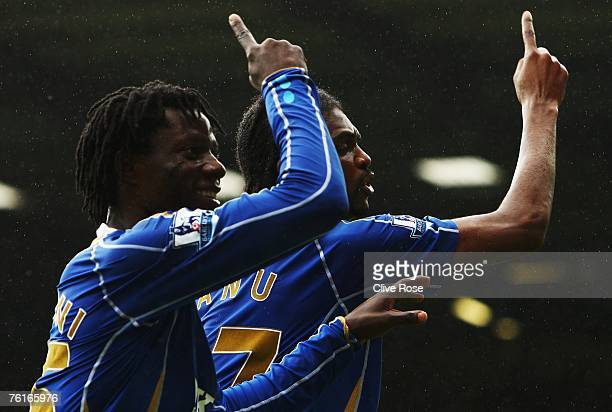 Kanu of Portsmouth celebrates his goal with Benjani during the Barclays Premiership match between Portsmouth and Bolton Wanderers at Fratton Park on...