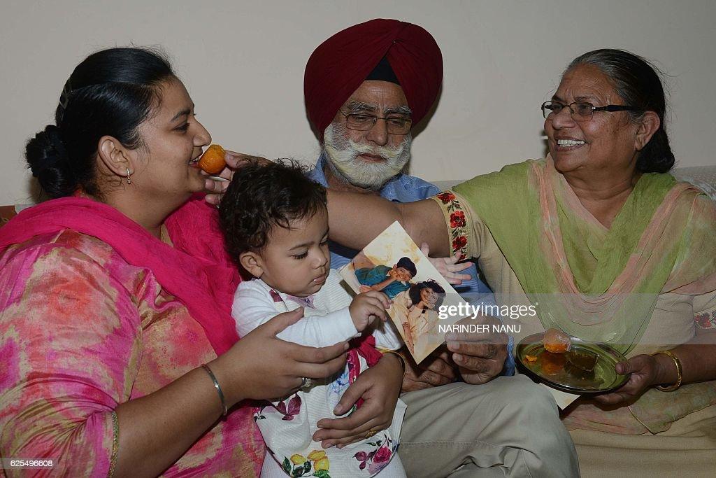 Kanwaljit Singh cousin of South Carolina governor Nikki Haley celebrates with his wife Charanjit Kaur and daughter inlaw Manjot Kaur in Amritsar on...