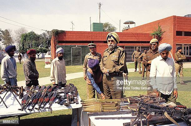 Kanwar Pal Singh Gill or KPS Gill DirectorGeneral of Police Punjab with arms and ammunation from surrendered militants