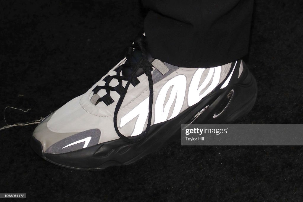 the latest cee71 16e01 Kanye West, Adidas Yeezy Boost 700 shoe detail, attends the ...