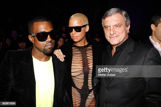 Kanye West, Amber Rose and Sidney Toledano attend the John Galliano fashion show during Paris Menswear Fashion Week Autumn/Winter 2010 on January 22,...