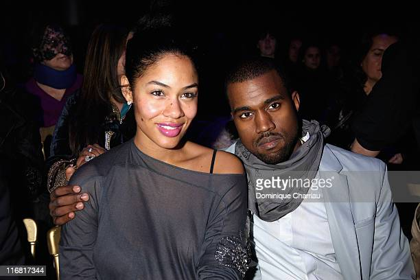 Kanye West and Alexis Phifer attend the John Galliano fashion show during Paris Fashion Week Fall/Winter 2008 held at the Grande Halle de la Vilette...