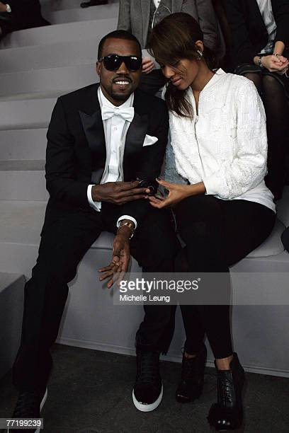 Kanye West and Alexis Phifer attend the Yves Saint Laurent PFW Spring Summer 2008 show at Paris Fashion Week 2007 on October 4 2007 in Paris France