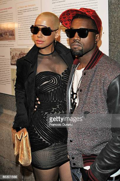 Kanye West and Amber Rose arrive at the Givenchy ReadytoWear A/W 2009 fashion show during Paris Fashion Week at Carreau du Temple on March 8 2009 in...