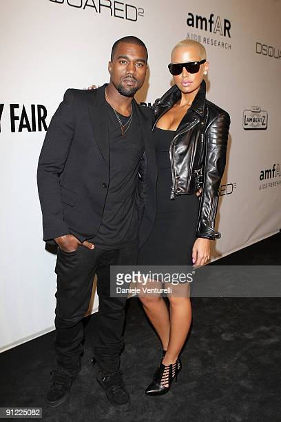 Kanye West and Amber Rose attend amfAR Milano 2009 Red Carpet the Inaugural Milan Fashion Week event at La Permanente on September 28 2009 in Milan...