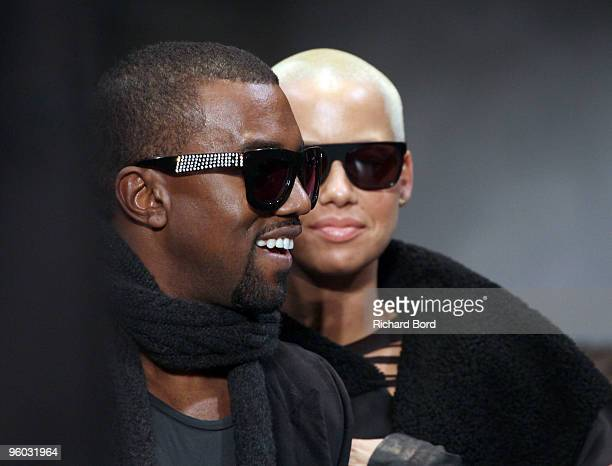 Kanye West and Amber Rose attend the Cerruti fashion show during Paris Menswear Fashion Week Autumn/Winter 2010 at Palais de Tokyo on January 22,...
