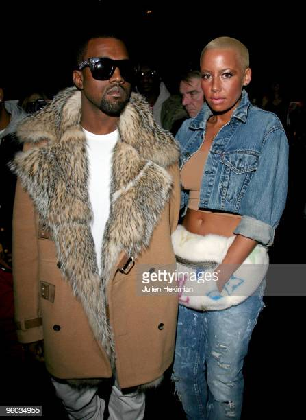 Kanye West and Amber Rose attend the Dior Homme fashion show during Paris Menswear Fashion Week Autumn/Winter 2010 on January 23 2010 in Paris France