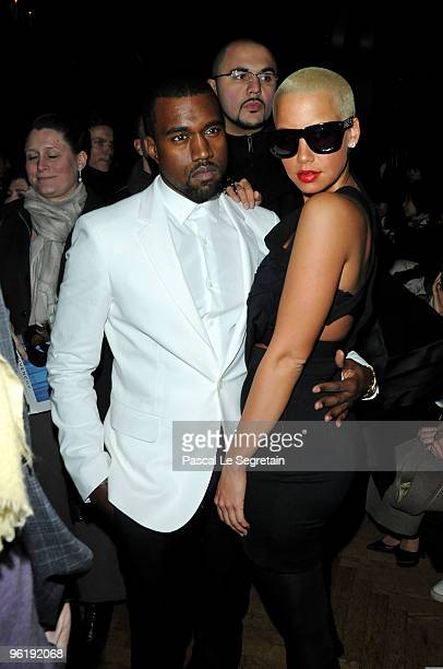 Kanye West and Amber Rose attend the Givenchy Fashion Show during Paris Fashion Week Haute Couture S/S 2010 on January 26 2010 in Paris France