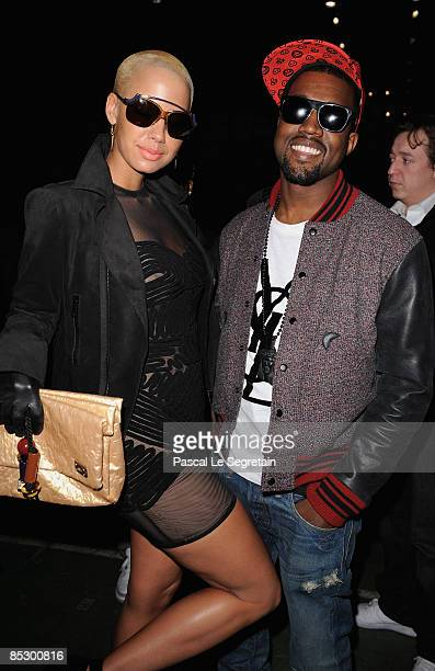 Kanye West and Amber Rose attend the Givenchy ReadytoWear A/W 2009 fashion show during Paris Fashion Week at Carreau du Temple on March 8 2009 in...