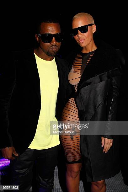 Kanye West and Amber Rose attend the John Galliano fashion show during Paris Menswear Fashion Week Autumn/Winter 2010 on January 22, 2010 in Paris,...