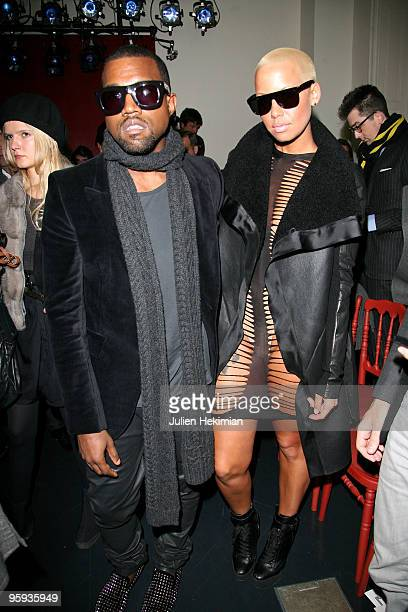 Kanye West and Amber Rose attend the Yves Saint-Laurent fashion show during Paris Menswear Fashion Week Autumn/Winter 2010 on January 22, 2010 in...