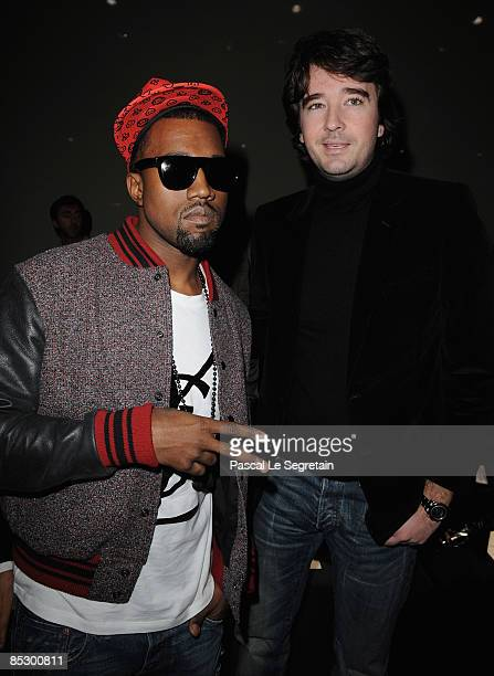 Kanye West and Antoine Arnault attend the Givenchy ReadytoWear A/W 2009 fashion show during Paris Fashion Week at Carreau du Temple on March 8 2009...