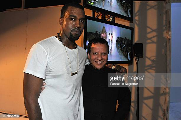 Kanye West and Azzedine Alaia attend the Dw by Kanye West Ready to Wear Spring / Summer 2012 show during Paris Fashion Week at Lycee Henri IV on...