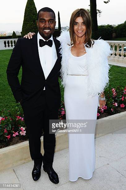 Kanye West and Carine Roitfeld attend amfAR's Cinema Against AIDS Gala during the 64th Annual Cannes Film Festival at Hotel Du Cap on May 19 2011 in...