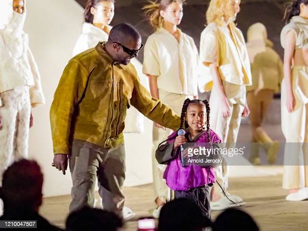 Kanye West and daughter North West attends the Yeezy Season 8 show as part of the Paris Fashion Week Womenswear Fall/Winter 2020/2021 on March 02...