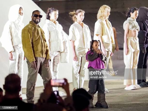 Kanye West and daughter North West on the runway of the Yeezy fashion show during Paris Fashion Week Womenswear Fall/Winter 2020/2021 on March 02...