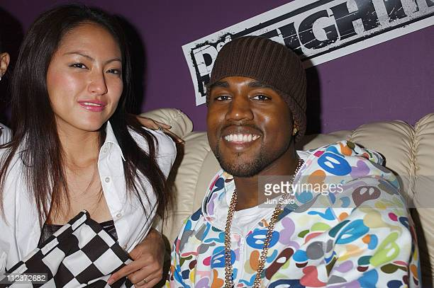 Kanye West and EA Games model during EA Games Hosts Def Jam Fight For NY featured Kanye West Party Backstage at Alife Club in Tokyo Japan