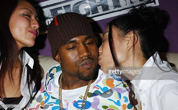 Kanye West and EA Games models during EA Games Hosts Def Jam Fight For NY featured Kanye West Party Backstage at Alife Club in Tokyo Japan