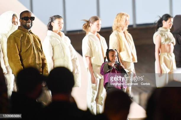 Kanye West and her daughter North West who sings on the runway during the Yeezy Season 8 show as part of the Paris Fashion Week Womenswear...
