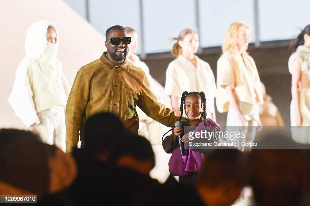 Kanye West and his daughter North West who sings on the runway during the Yeezy Season 8 show as part of the Paris Fashion Week Womenswear...