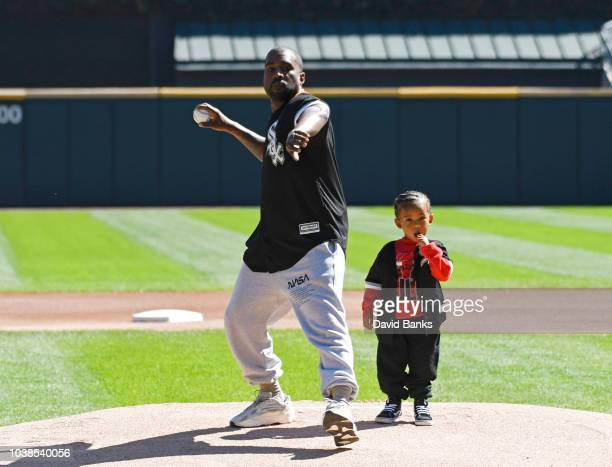 Kanye West and his son Saint throw out a ceremonial first pitch before the game between the Chicago White Sox and the Chicago Cubs on September 23...