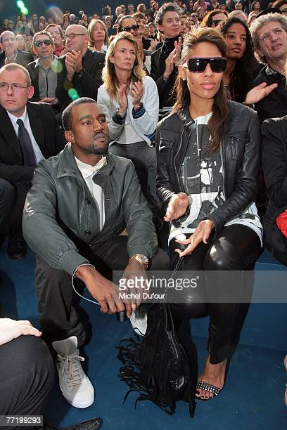 Kanye West and his wife Alexi attend the Chanel fashion show during the Spring/Summer 2008 readytowear collection show at Grand Palais on October 5...