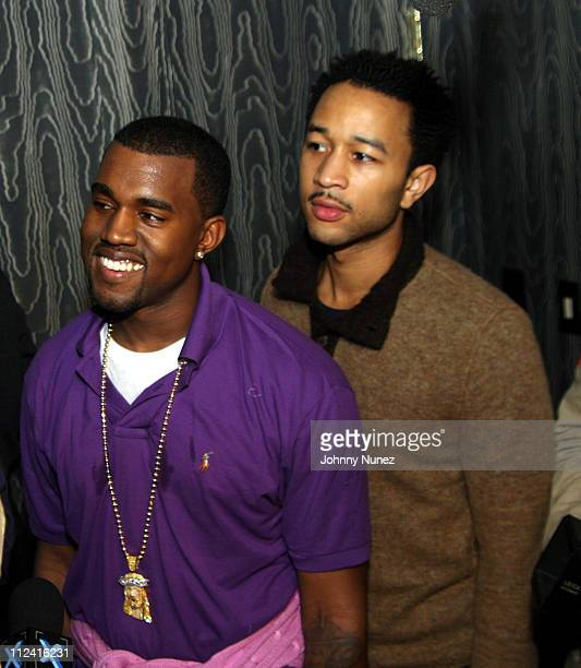 Kanye West and John legend during Roc Box Presents Kanye West in Concert - October 8, 2005 at Hard Rock Cafe in New York City, New York, United...