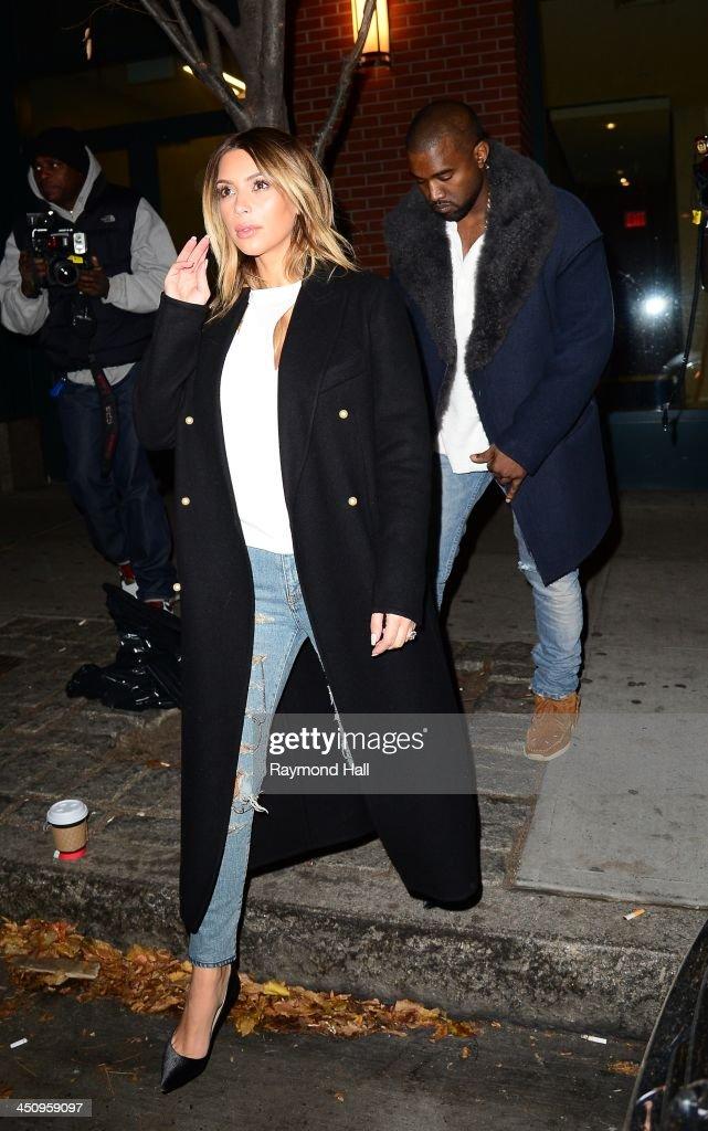 Kanye West and Kim Kardashian are seen walking in Soho on November 20, 2013 in New York City.
