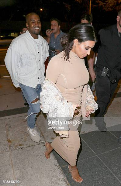 Kanye West and Kim Kardashian arrive at Komodo restaurant to celebrate nightclub owner David Grutman's wedding on April 22 2016 in Miami Florida