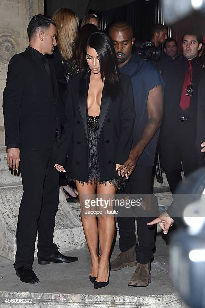 Kanye West and Kim Kardashian arrive at Lanvin Fashion Show during Paris Fashion Week Womenswear SS 2015 on September 25 2014 in Paris France