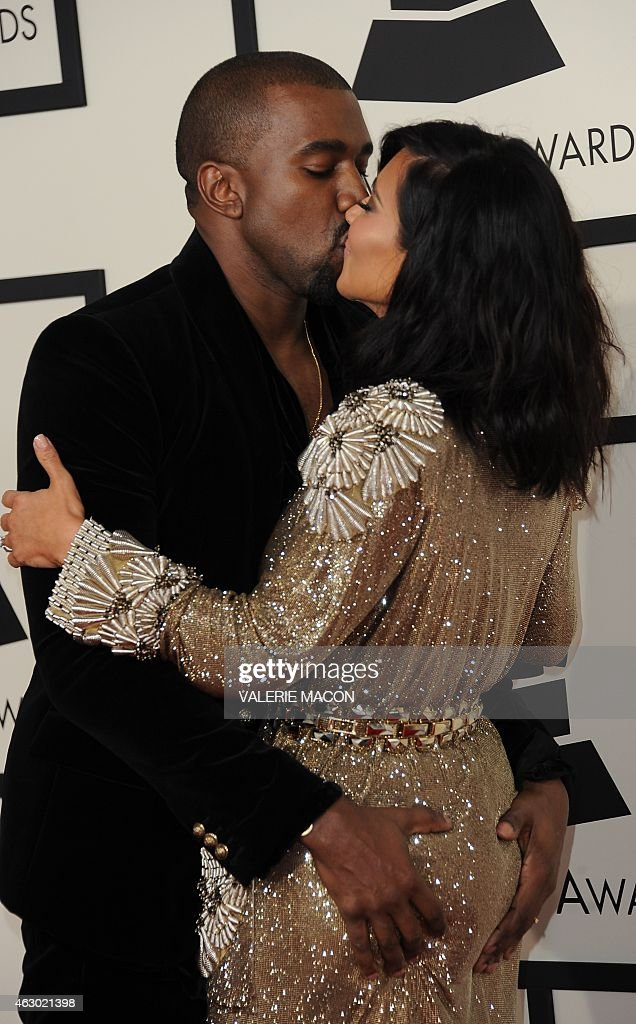 Kanye West and Kim Kardashian arrive on the red carpet for the 57th Annual Grammy Awards in Los Angeles February 8, 2015.