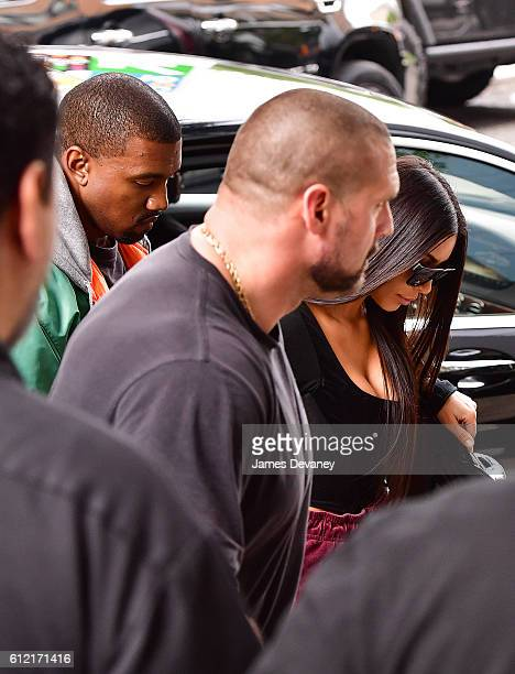 Kanye West and Kim Kardashian arrive to their Manhattan apartment after Kim was robbed in her Paris France hotel room on October 3 2016 in New York...