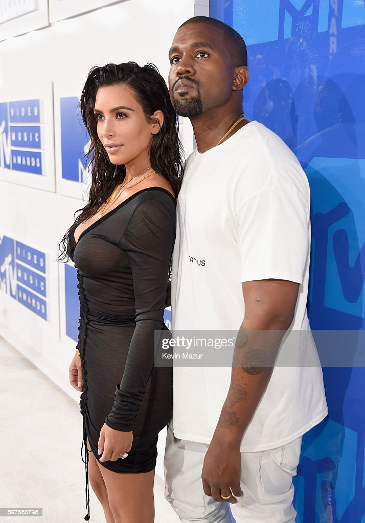 Kanye West (L) and Kim Kardashian attend the 2016 MTV Video Music Awards at Madison Square Garden on August 28, 2016 in New York City.
