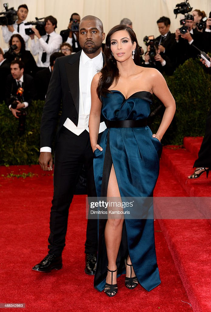 Kanye West (L) and Kim Kardashian attend the 'Charles James: Beyond Fashion' Costume Institute Gala at the Metropolitan Museum of Art on May 5, 2014 in New York City.