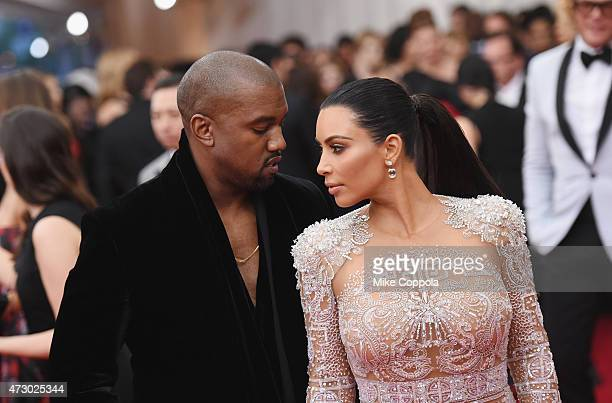 Kanye West and Kim Kardashian attend the China Through The Looking Glass Costume Institute Benefit Gala at the Metropolitan Museum of Art on May 4...