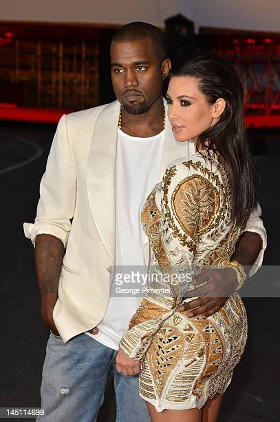 Kanye West and Kim Kardashian attend the Cruel Summer Premiere during the 65th Annual Cannes Film Festival at Palm Beach on May 23 2012 in Cannes...