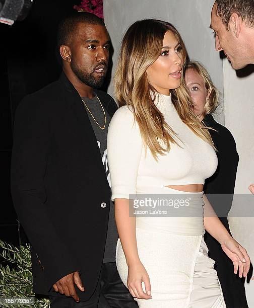 Kanye West and Kim Kardashian attend the Dream For Future Africa Foundation gala at Spago on October 24, 2013 in Beverly Hills, California.