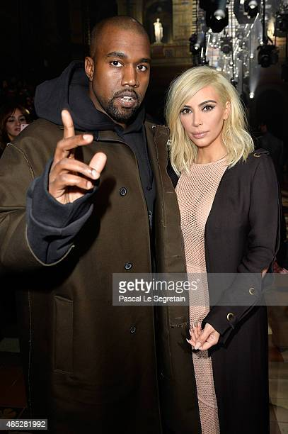 Kanye West and Kim Kardashian attend the Lanvin show as part of the Paris Fashion Week Womenswear Fall/Winter 2015/2016 on March 5 2015 in Paris...