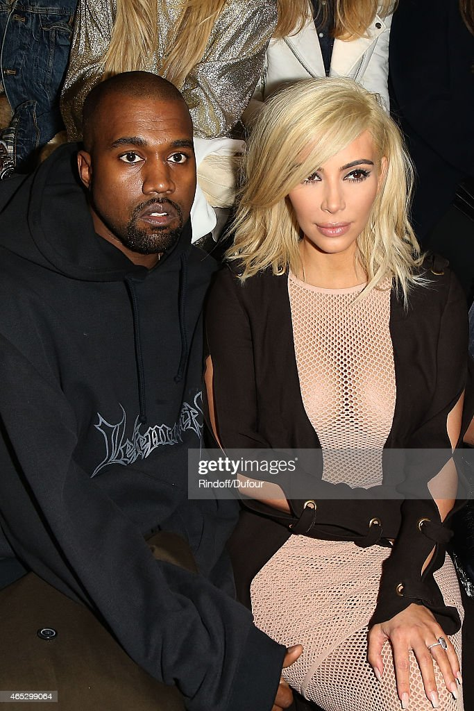Kanye West and Kim Kardashian attend the Lanvin show as part of the Paris Fashion Week Womenswear Fall/Winter 2015/2016 on March 5, 2015 in Paris, France.