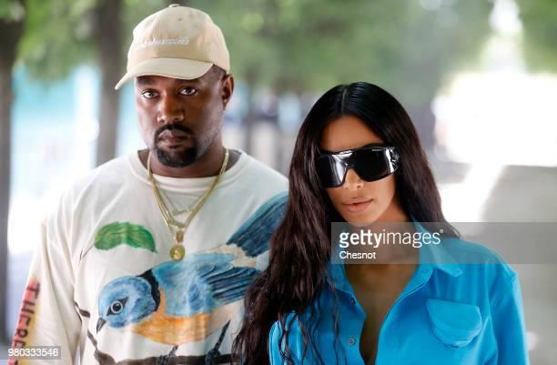 Kanye West and Kim Kardashian attend the Louis Vuitton Menswear Spring/Summer 2019 show as part of Paris Fashion Week Week on June 21 2018 in Paris...