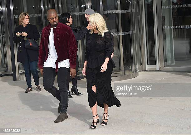 Kanye West and Kim Kardashian depart the Louis Vuitton show as part of Paris Fashion Week Fall Winter 2015/2016 on March 11 2015 in Paris France