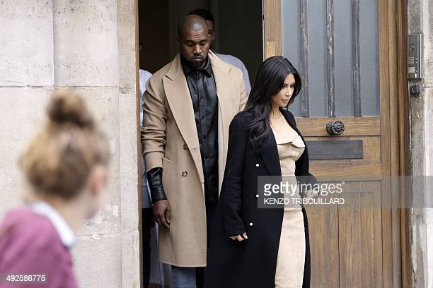 Kanye West and Kim Kardashian exit a building in rue Darboy in the 11th district near Belleville on May 21 2014 in Paris The celebrity pair is...