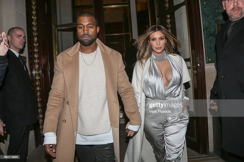Kanye West and Kim Kardashian leave the 'Meurice' hotel on January 21, 2014 in Paris, France.