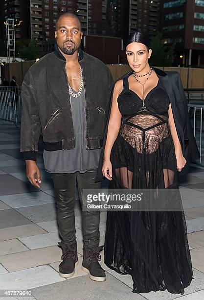 Kanye West and Kim Kardashian West are seen arriving at the Givenchy fashion show during Spring 2016 New York Fashion Week on September 11 2015 in...