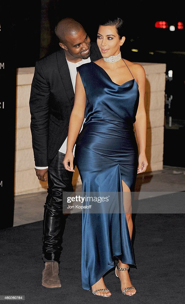 Kanye West and Kim Kardashian West arrive at the 2014 LACMA Art + Film Gala Honoring Quentin Tarantino And Barbara Kruger at LACMA on November 1, 2014 in Los Angeles, California.