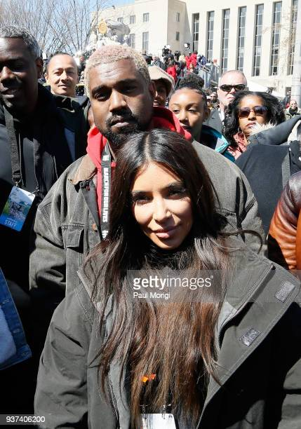 Kanye West and Kim Kardashian West attend March For Our Lives on March 24 2018 in Washington DC