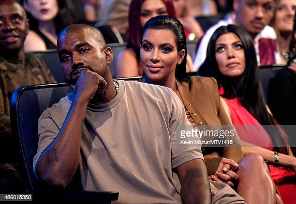 Kanye West and Kim Kardashian West attend the 2015 MTV Video Music Awards at Microsoft Theater on August 30 2015 in Los Angeles California