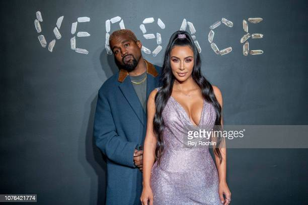 Kanye West and Kim Kardashian West attend the the Versace fall 2019 fashion show at the American Stock Exchange Building in lower Manhattan on...