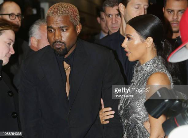 Kanye West and Kim Kardashian West pose at the opening night of the new musical 'The Cher Show' on Broadway at The Neil Simon Theatre on December 3...
